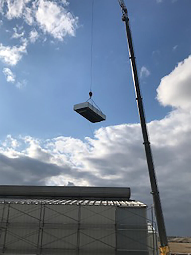 crane holding metal hvac